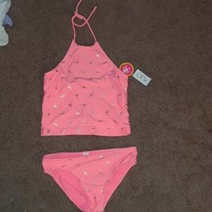 A girls pink and gold bathing suit